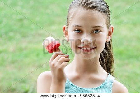 Child Eating Healthy Fruit Popsicle