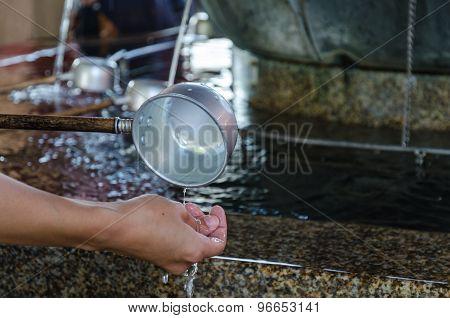 A water ladle at the purification pavilion (a chozuya or temizuya) poster