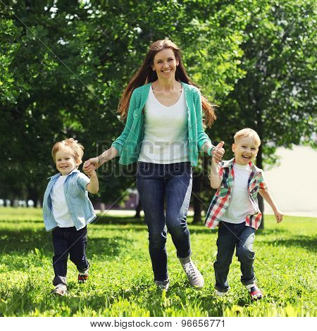 Portrait Of Happy Family Having Fun Together Outdoors At The Weekend, Mother And Two Children Sons P