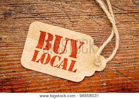 buy local  sign a paper price tag against rustic red painted barn wood - shopping concept