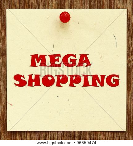 Notice written MEGA SHOPPING in a notice board poster