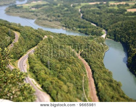 Nice Diorama Effect With Road And River And Rails, France, Alps