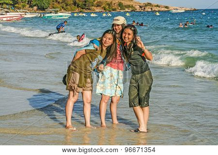 Japanese Tourists Pose For A Selfy At The Beach