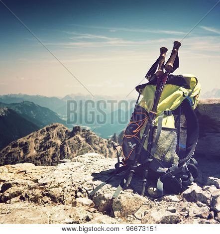 Backpack or rucksack balanced against a rock on top of a mountain summit in the Alps, Hochvogel, Germany, conceptual of a healthy, active outdoor lifestyle and sport