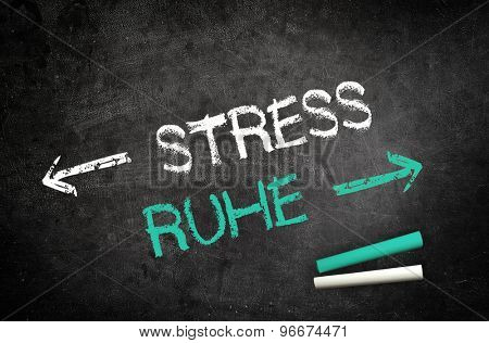 Conceptual Stress and Silence Message Written on a Black Chalkboard with Chalk Sticks in the Lower Right Corner.