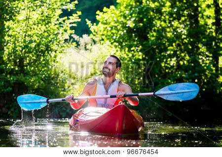 Man paddling with kayak on river for water sport