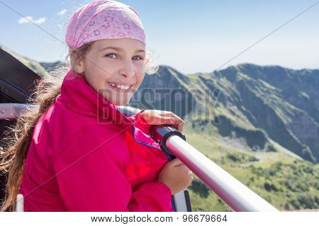 Girl admiring the mountains from the chair lift