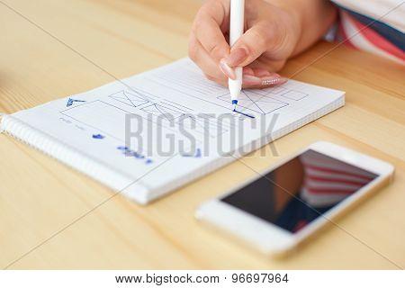 Graphic Designer Sketching Web Design