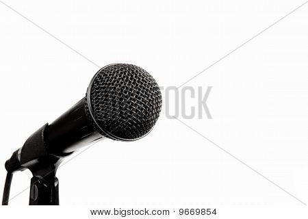 A black microphone on a white background