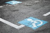 Road marking of place for disabled persons on urban parking lot poster