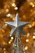 silver christmas star decoration on golden background poster