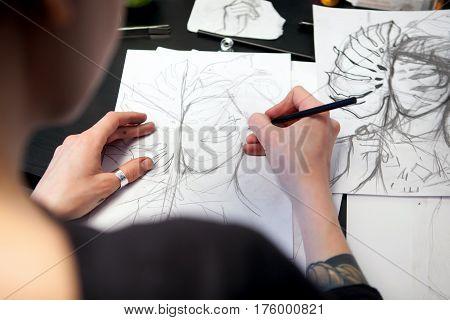 Girl Tattoo Artist Draws A Sketch. Close-up Of Hands