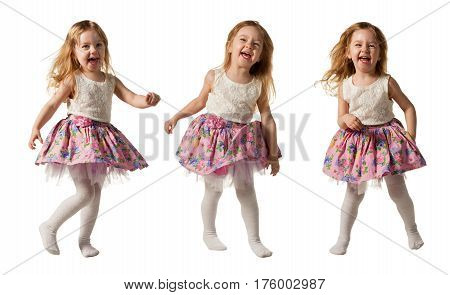 Little laughing girl jumping, running, dancing. Isolated on white background