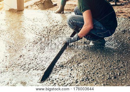 Plasterer Concrete Worker At Floor Of House Construction