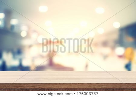 Empty Wooden Table For Product Placement Or Montage And Blurred Terminal Department At Airport Backg