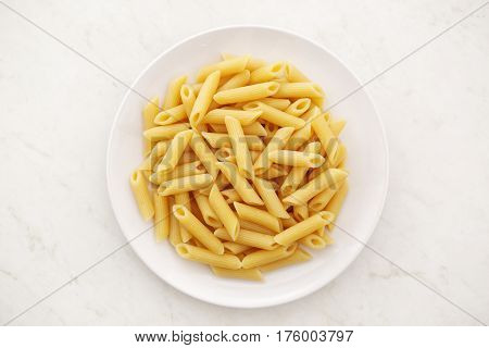 cooked Penne alla vodka pasta without sauce. top view