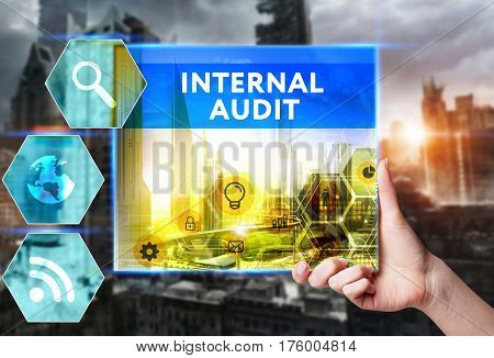 Technology, Internet, Business And Marketing. Young Business Woman Writing Word: Internal Audit