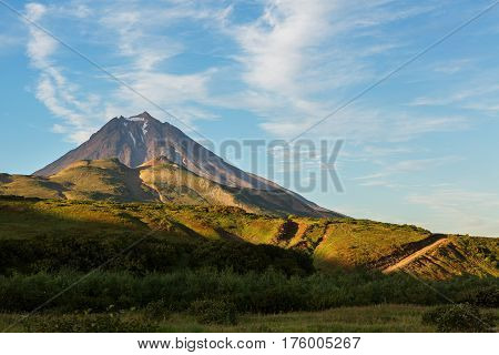 Vilyuchinsky stratovolcano at dawn. View from the brookvalley Spokoyny at the foot of outer north-eastern slope of caldera volcano Gorely.