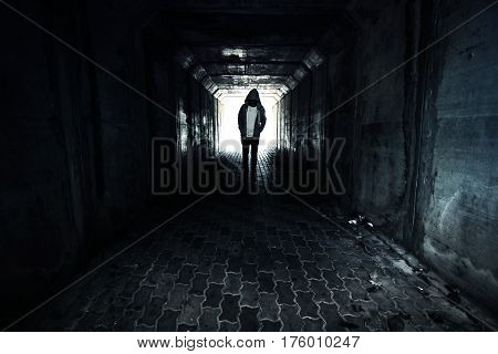 Stranger or homeless person walking in tunnel