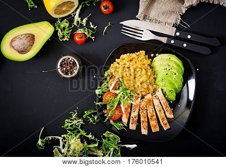 Healthy Dish With Chicken, Tomatoes,  Avocado, Lettuce And Lentil On Dark  Background. Dinner . Flat