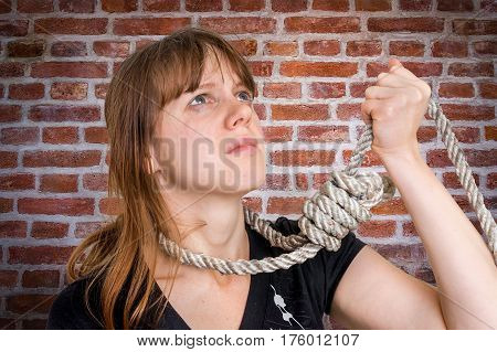 Depressed Woman With A Noose Around Her Neck