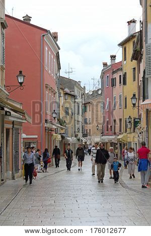 ROVINJ CROATIA - OCTOBER 15: People Walking at Pedestrian Zone in Rovinj on OCTOBER 15 2014. Tourists at Carrera Street in Rovinj Croatia.