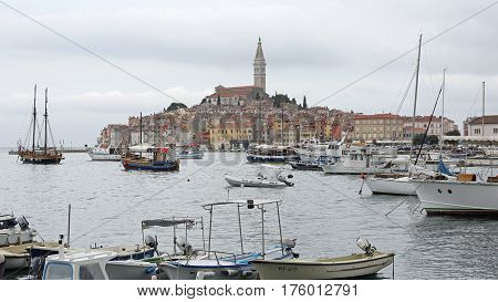 ROVINJ CROATIA - OCTOBER 15: Town and Port in Rovinj on OCTOBER 15 2014. Church Tower and Colorful Houses at Seafront in Rovinj Croatia.