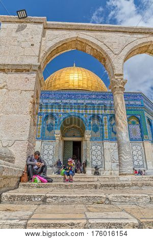 JERUSALEM, ISRAEL - MAY 23, 2016: Father and son visiting the Dome of the Rock, an Islamic shrine located on the Temple Mount in the Old City.