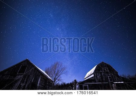 Rural Barns At Night With Stars In Winter