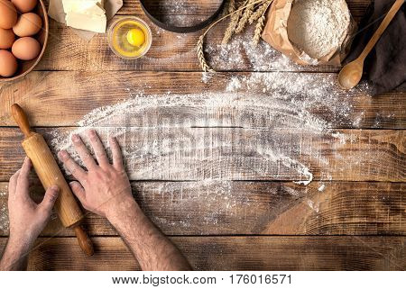 Baker preparing to knead the dough top view. Cooking bakery concept