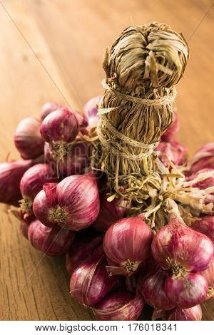 close up shallots group on wood background