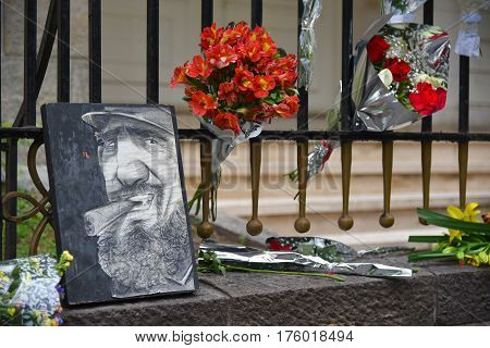 Buenos Aires Argentina - Nov 26 2016: Portrait of Fidel Castro and flowers at the Embassy of Cuba in Buenos Aires Argentina.