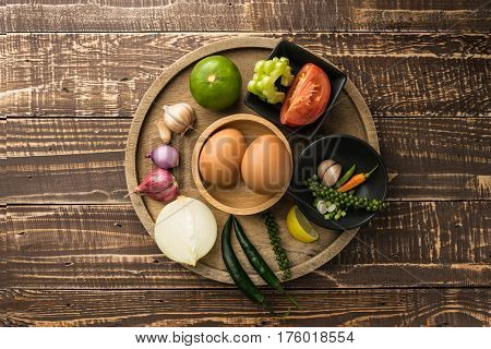 egg and spice for cook healthy on table wood background in top veiw