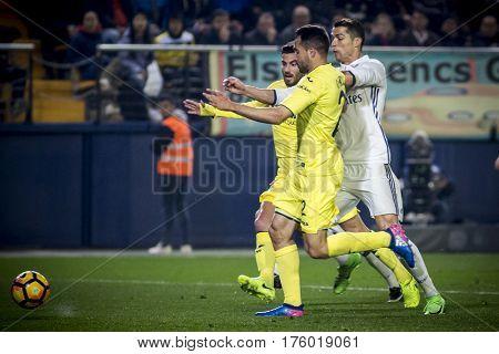 VILLARREAL, SPAIN - FEBRUARY 26:(R) Ronaldo fight for the ball during La Liga match between Villarreal CF and Real Madrid at Estadio de la Ceramica on February 26, 2017 in Villarreal, Spain