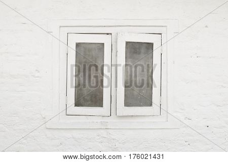 White window and white brick wall