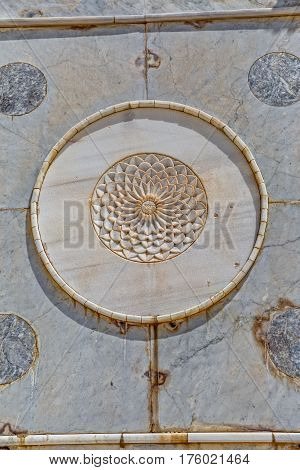 Relief of the white flower in circle on the wall of the Dome of the Rock an Islamic shrine located on the Temple Mount in the old city Jerusalem, Israel.