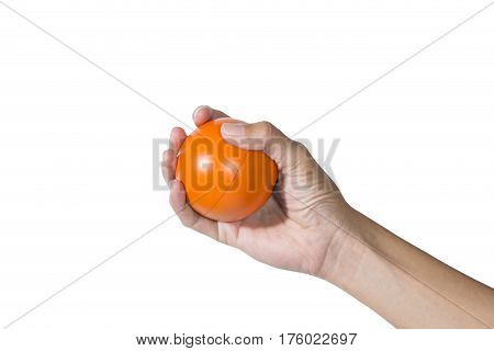 Hand of a woman holding a stress ball on white background