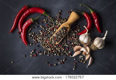 Garlic peper and chili peppers on a dark background