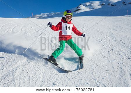 Little skier training to make the stem turn walking down a hill