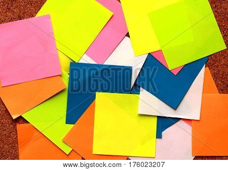 Colurful sticky notes with pin on a cork board