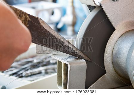 Sharpening knife of a shoemaker on grinding machines poster