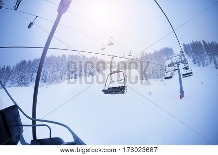 View from the cabin of chairlift on snowcapped slopes at ski resort