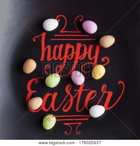 Happy Easter Hand Lettering Calligraphy Phrase On Black Background, Decorated With Sugar Coated Spec