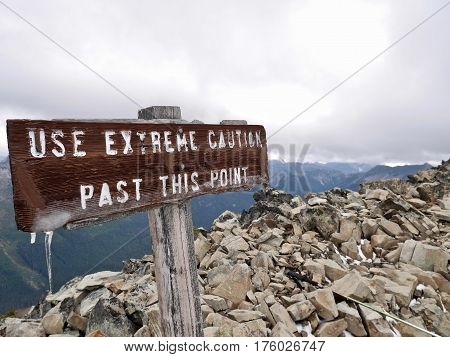 Sign Extreme Caution on Frosty Mountain in Manning Park. Hope. Vancouver. British Columbia. Canada.