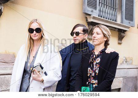 MILAN ITALY - FEBRUARY 25: Fashionable people pose outside Blumarine fashion show during Milan Women's Fashion Week on FEBRUARY 25 2017 in Milan.