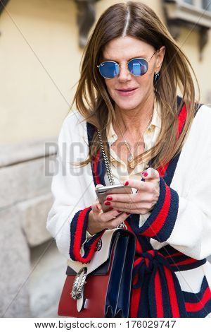 MILAN ITALY - FEBRUARY 25: Anna Dello Russo walks outside Blumarine fashion show during Milan Women's Fashion Week on FEBRUARY 25 2017 in Milan.