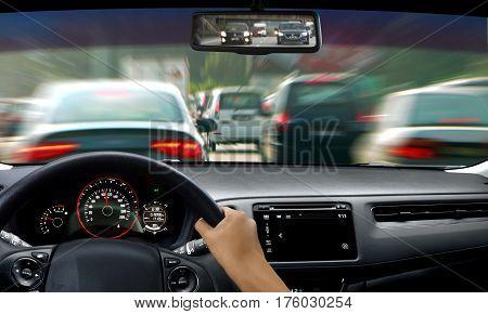 Hand on steering wheel during traffic jam