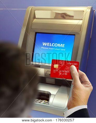 Men at ATM machine doing banking transaction
