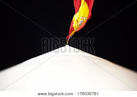 Spanish flag in the Colon square of Madrid at night. Picture taken from the mast