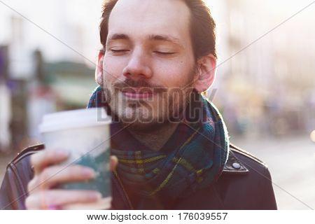 Scarfed Man Enjoying Warm Beverage